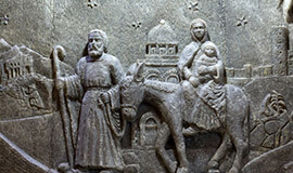 A relief made in the salt of a shepherd leading a horse carrying a mother and baby.