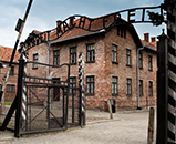 A picture of the entrance to Auschwitz and the infamous 'arbeit macht frei' sign